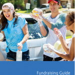 three students washing a car for fundraising
